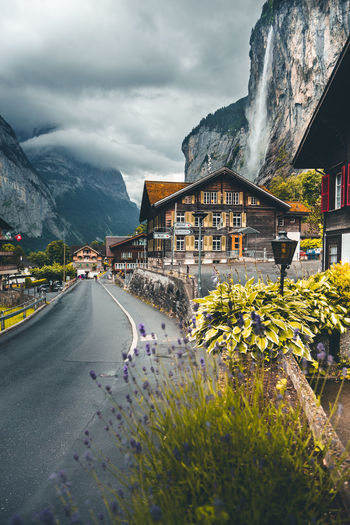 Architecture Built Structure Mountain Building Exterior Road Sky Nature Flower Building Plant Cloud - Sky Flowering Plant Transportation Day City Beauty In Nature Mountain Range Residential District House Outdoors No People Lauterbrunnen Valley Lauterbrunnen Fog Beauty In Nature