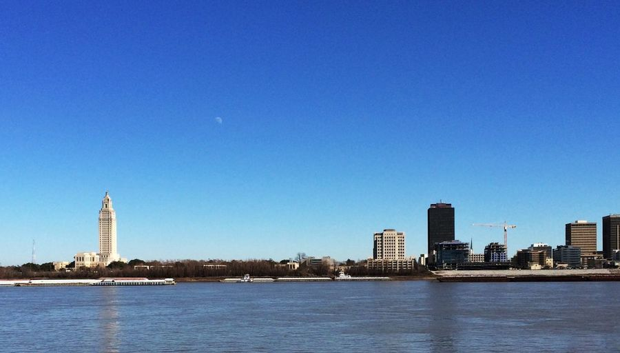 Mississippi River And City Against Clear Blue Sky