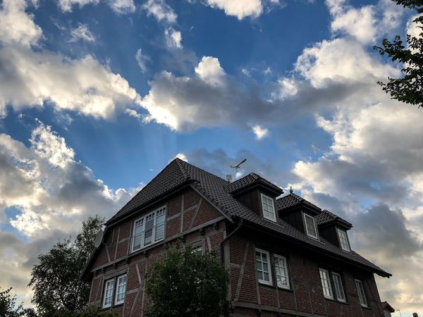 Fehmarn Cloud - Sky Low Angle View Sky Built Structure Architecture Building Exterior Building Nature Tree Day No People Plant Outdoors Sunlight Travel Destinations City Residential District Office Building Exterior Construction Industry High Section