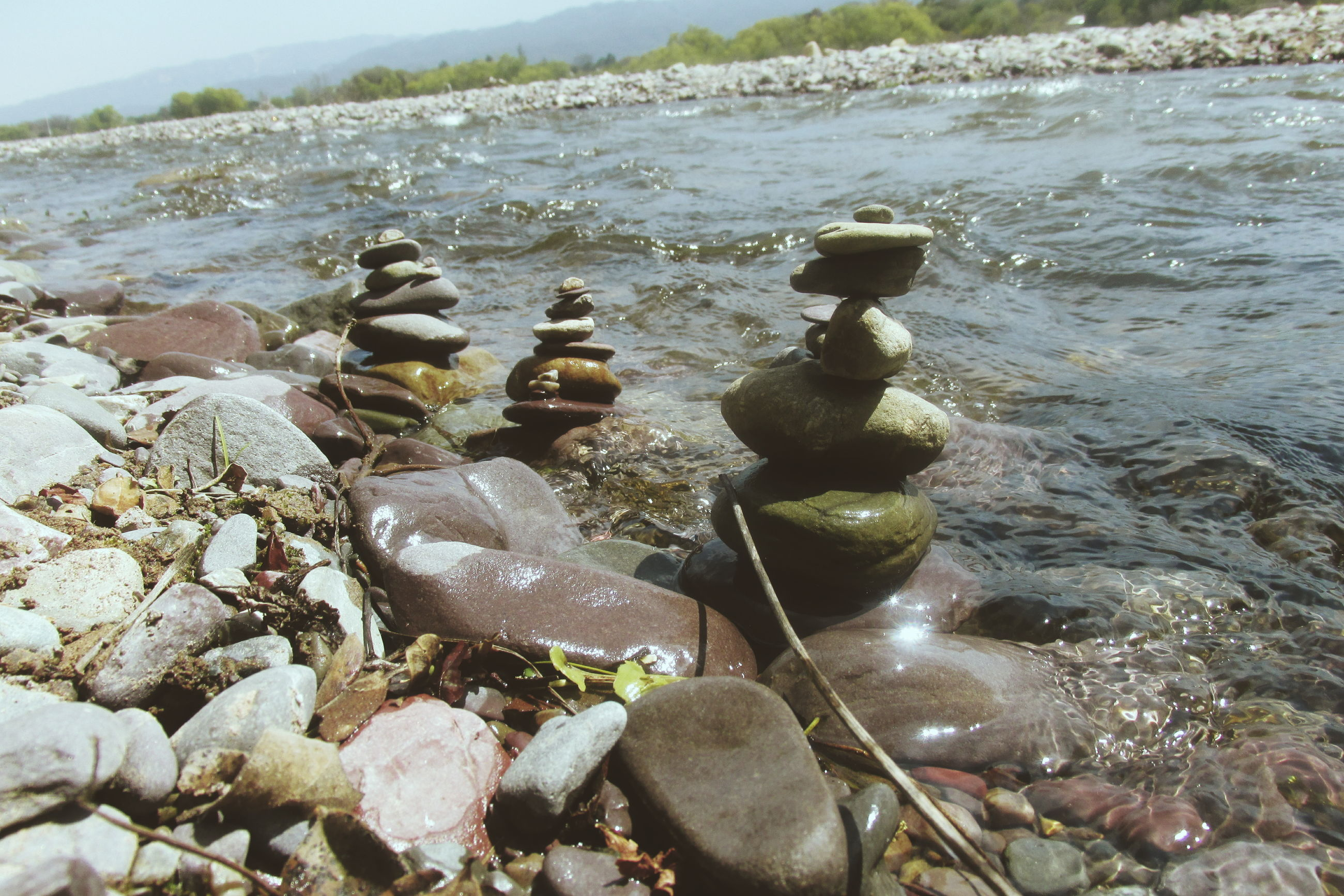 water, rock - object, tranquility, stone - object, nature, tranquil scene, stack, pebble, beauty in nature, stone, scenics, abundance, reflection, day, rock, lake, outdoors, no people, large group of objects, idyllic