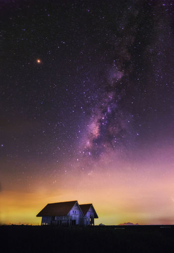Scenic view of house against sky at night