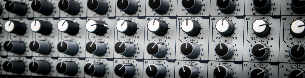 Full frame shot of sound mixer knobs