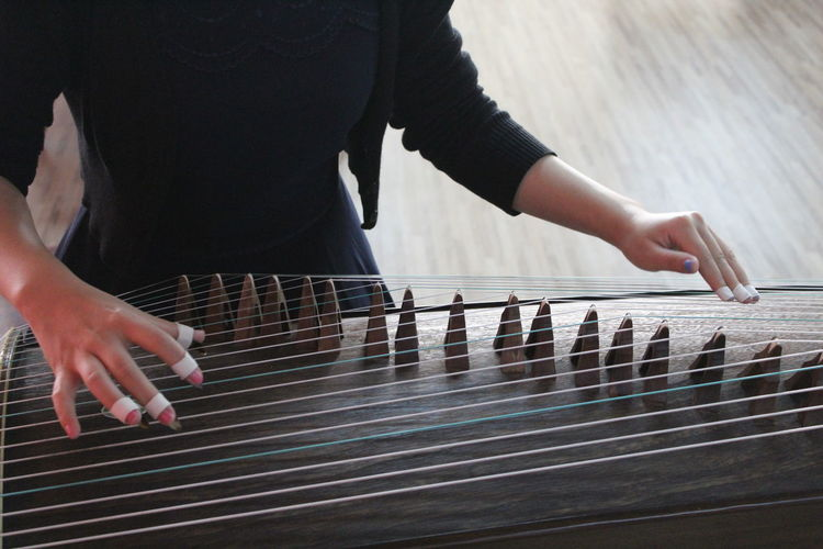 Woman Playing Guzheng Indoors
