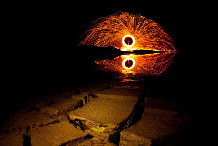 Steel Wool in Indonesia Night Illuminated Orange Color Nature Motion Glowing Wire Wool Land Burning No People Fire Long Exposure Light - Natural Phenomenon Outdoors Dark Flame Blurred Motion Spinning Fire - Natural Phenomenon Field