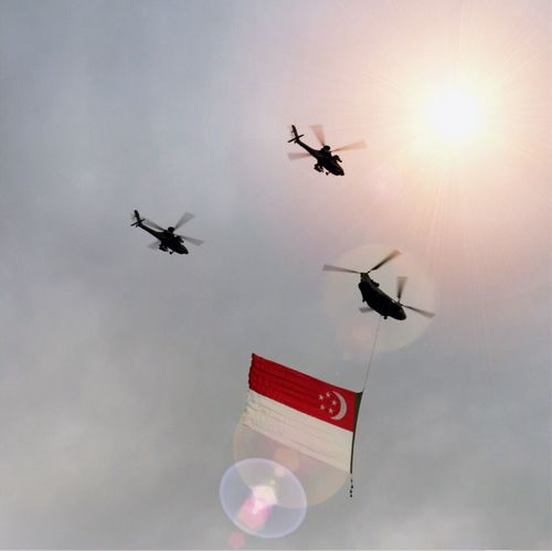 Flying high. Flying Chinook Millitary Helicopter Fly Flag Singapore National Flag Nationalday Plane