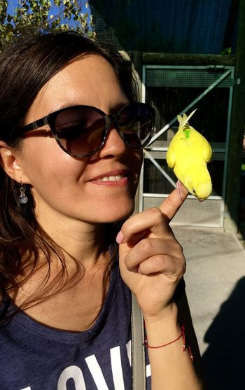 Pet Love Bird Close-up Happiness Holding Human And Animals One Person Parrot People And Animals Pet Portrait Real People Self Portrait Selfie Selfportrait Smiling Sunglasses Yellow Perrot Young Adult Young Women