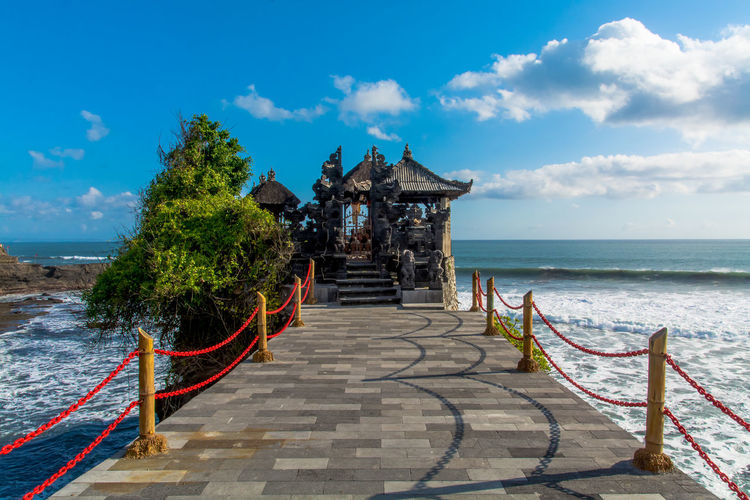 Architecture Bali, Indonesia Balinese Culture Blue Clouds And Sky Day Horizontal No People Ocean Outdoors Place Of Worship Pura Batu Bolong Religion Religious Architecture Scenics Sea Sea Temple Sky Sunny Day Tranquility Travel Destinations Tree Tree Vacations Water