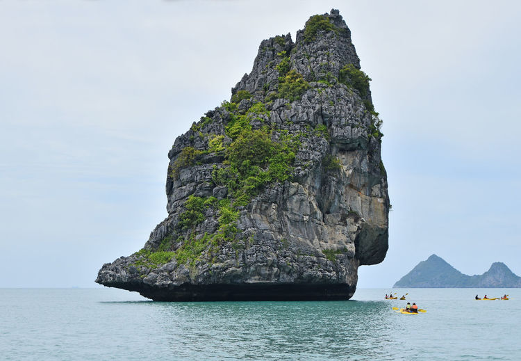 Island at Ang Thong National Marine Park of Thailand Adventure Ang Thong National Marine Park Angthong Boat Cliff Geology Kayak Kayaking Nature Rock Rock - Object Rock Formation Rocky Sea Sky The KIOMI Collection Tourism Tranquility Travel Destinations Vacations Water Telling Stories Differently The Great Outdoors With Adobe People Of The Oceans