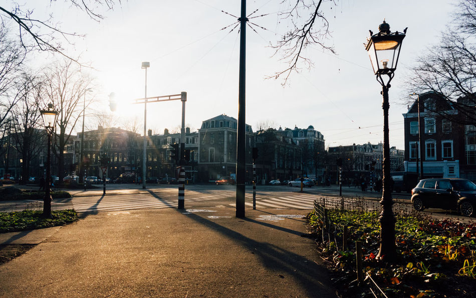 Golden hour in Amsterdam. Amsterdam Amsterdamcity Architecture Building Exterior Built Structure City Day Nature No People Outdoors Sky Steert Street Street Light Street Photography Streetphotography Transportation Tree Winter