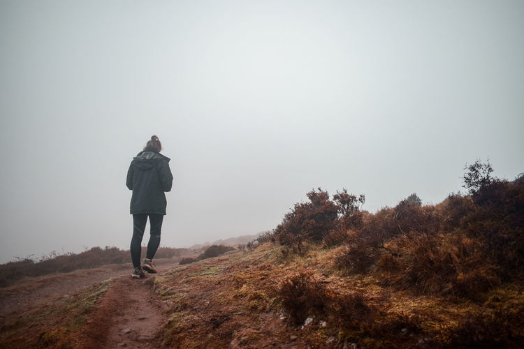 Into the fog... Woman Female Female Hiker Young Woman Fog Foggy Footpath Winter Dry Grass Rambler Walking Exploring Towards The Light Rising Full Length Adventure Warm Clothing Winter Sport Hiking Healthy Lifestyle Hiker Uphill Pursuit - Concept Chasing Mountain Climbing Silhouette
