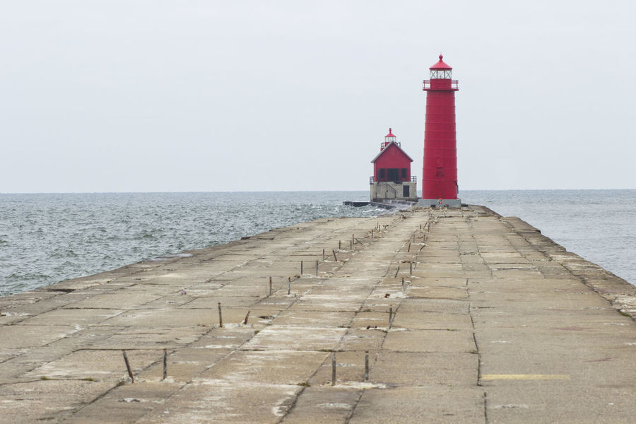 South Haven Lighthouse Architecture Attraction Day Lake Michigan, Lake, Windy, Great Lakes, Lighthouse, Winter, Clouds, Waves, Water, Landscape Lighthouse Lighthouse_lovers Memorial Michigan Circle Tour Outdoors Pier Red Refurbishing SignSignEverywhereASign Sky Snow ❄ South Haven, Michigan Tourism Travel Photography Water Weather