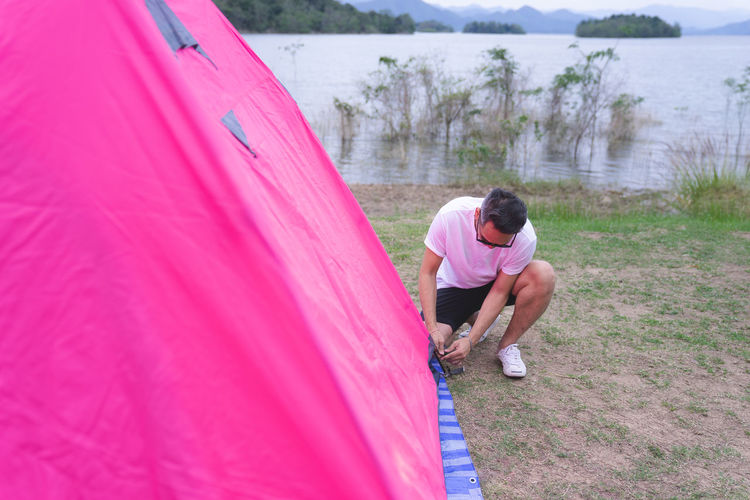 Real Man Tent Setting Sun Pink Color Travel Camping Real People Two People Full Length Leisure Activity Women Lifestyles Togetherness Casual Clothing Day Bonding People Love Adult Water Nature Men Couple - Relationship Emotion Females Positive Emotion Outdoors Shorts