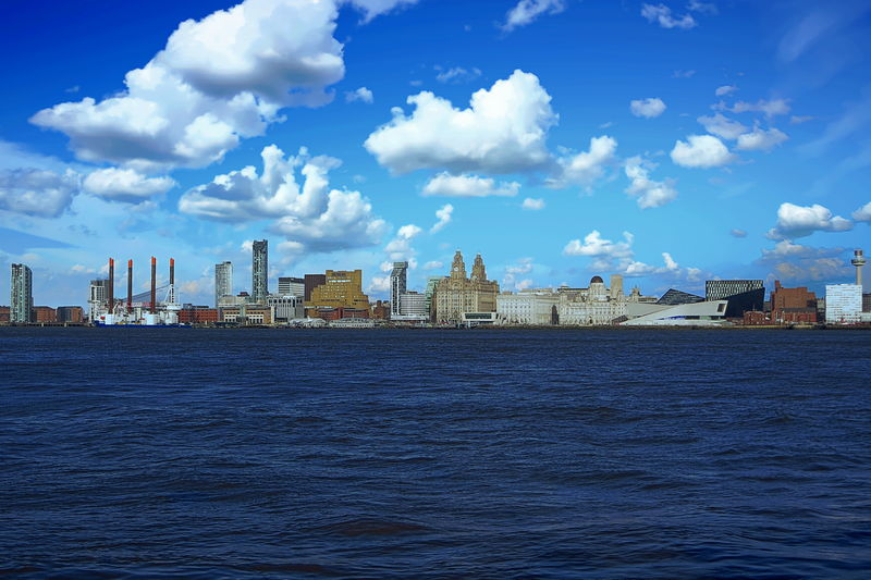 View of the Mercey River and Liverpool skyline, United Kingdom Building Exterior Built Structure Architecture Waterfront Cloud - Sky Sky Building Water City Sea No People Day Office Building Exterior Cityscape Skyscraper Landscape Office Urban Skyline Outdoors Spire  Financial District  Liverpool United Kingdom Mercey River Skyline