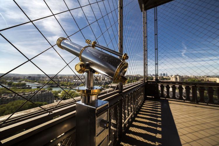 Close-up of suspension bridge against sky