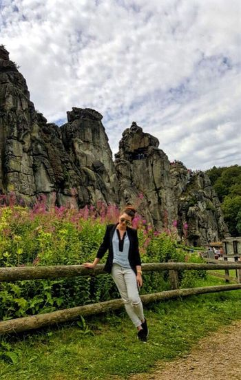 Externsteine in Horn-Bad Meinberg, nrw Sky Full Length Real People Cloud - Sky Grass Nature Women Outdoors One Person Lifestyles Beauty In Nature Flower Mountain Leisure Activity Day One Woman Only Adults Only Young Adult Only Women Adult