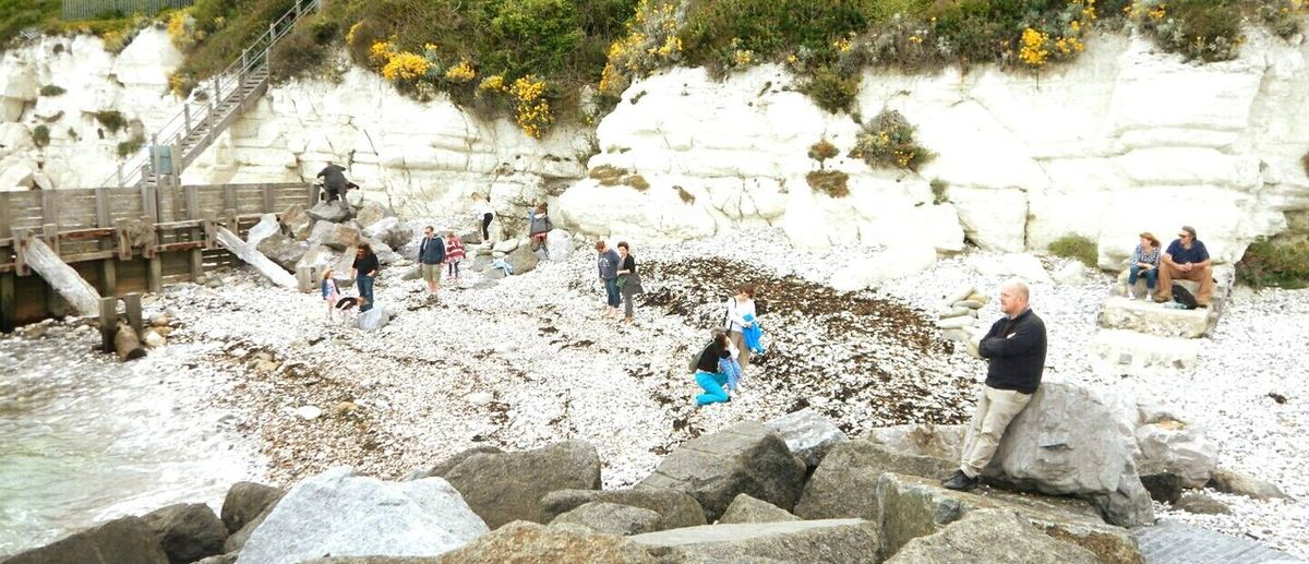 Large Group Of People Day Outdoors Live For The Story Beach People Cliffs Stories Real People Beach Photography Pebbles And Stones Cliff Rocks Groyne Sea
