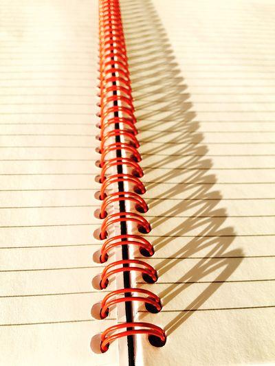 Close-up of spiral bound notebook