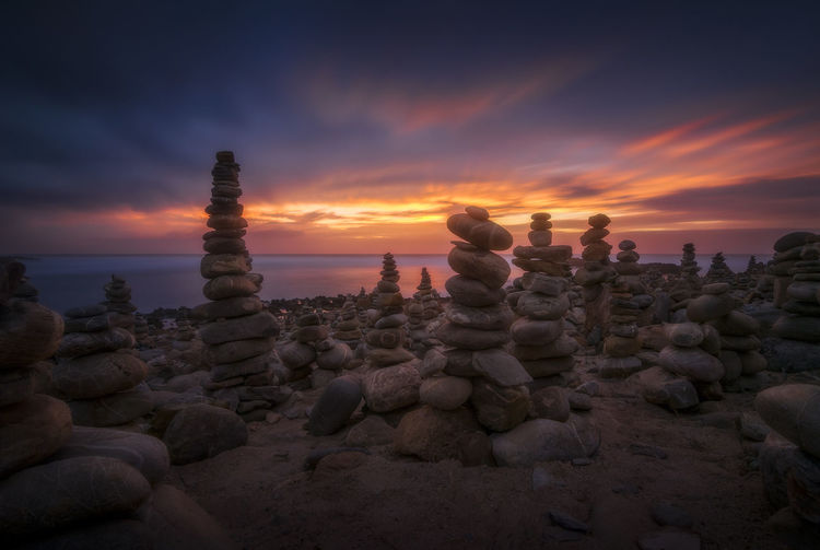 Sky Sunset Cloud - Sky Solid Rock Stack Beauty In Nature Stone - Object Rock - Object Water Orange Color Balance Scenics - Nature Outdoors Sunset_collection Rock Balancing Portugal Portugaldenorteasul Portugal_em_fotos Vila Nova De Milfontes EyeEm Best Shots EyeEmNewHere EyeEm Selects EyeEm Nature Lover Landscape_photography
