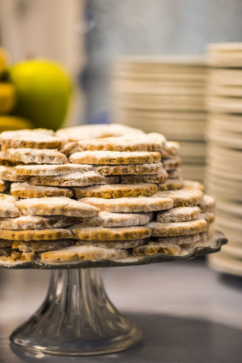 Close-Up Of Cookies Arranged On Stand At Table