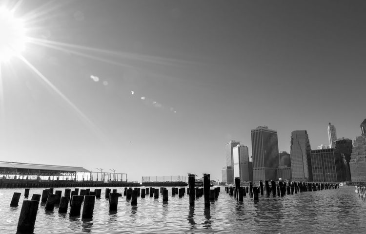 Sunburst over the East River and Lower Manhattan in black and white. East River Global Warming Manhattan Solar Flare Sunburst Architecture Black And White Building Exterior Built Structure City Clear Sky Climate Change Day Modern No People Outdoors Sky Skyscraper Sunlight Swimming Pool Terrorism Travel Destinations Urban Skyline Water Waterfront