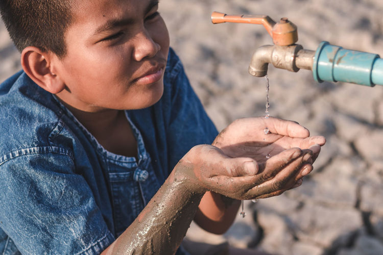 Drought Boy Childhood Close-up Drop Human Hand Lifestyles One Person Outdoors Water