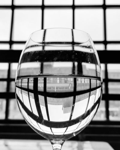 Glass - Material Drink Drinking Glass Reflection Single Object Alcohol Wineglass Black And White Mobilephotography Black And White Photography B&w Street Photography Social Issues Time Warp Time Warp Tunnel Lost Soul What Is Real? What Is Reality