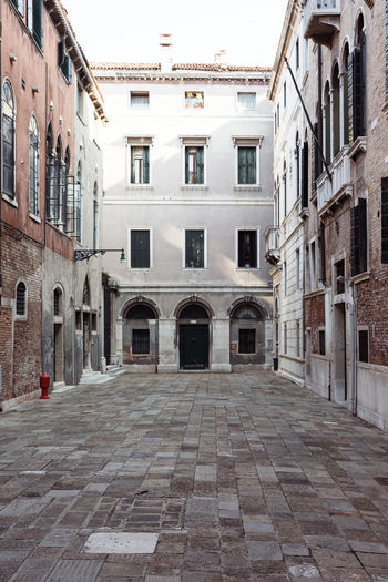 Alley Arch Architecture Building Building Exterior Built Structure City Cobblestone Courtyard  Day Direction Door Entrance Footpath History No People Outdoors Residential District Street The Past The Way Forward Venice Window