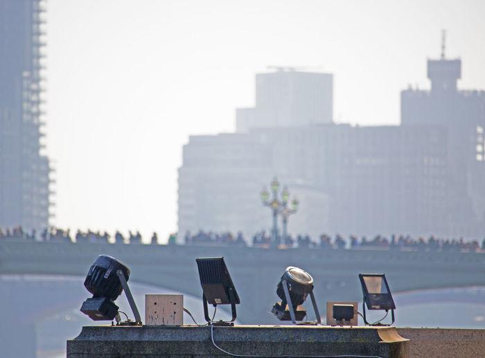 People sitting against buildings in city