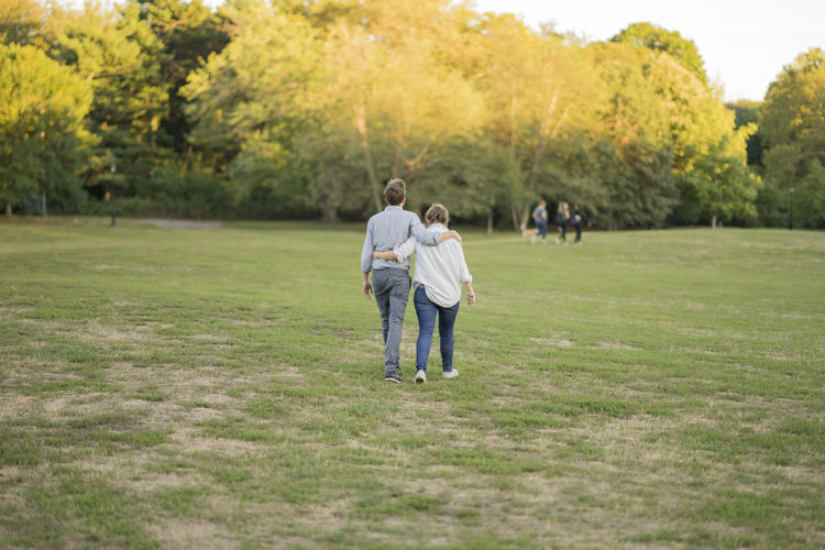 Adult Bonding Day Family Full Length Grass Happiness Males  Men Nature Outdoors Park People Rear View Strolling Togetherness Tree Two People Walk Women