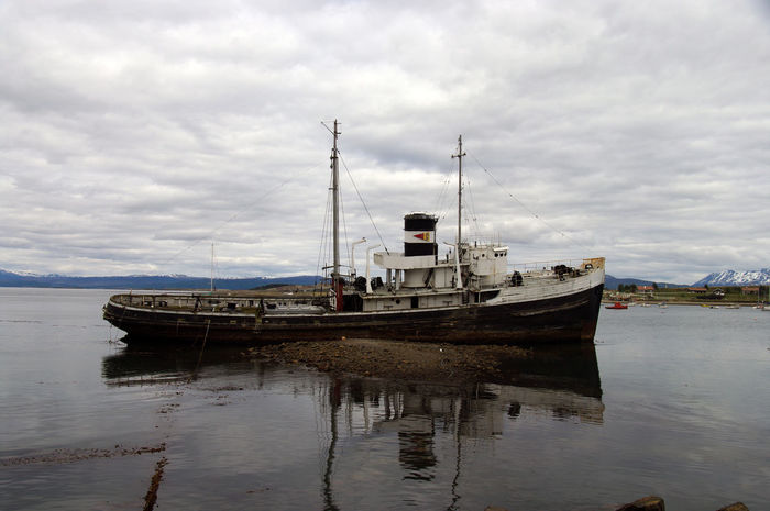 Saint Christopher's shipwreck in Ushuaïa's bay Tierra Del Fuego Ushuaïa Argentina Beauty In Nature Boat Cloud - Sky Day End Of The World Mast Mode Of Transport Moored Nature Nautical Vessel No People Outdoors Patagonia Sailing Saint Christopher Sea Ship Sky Transportation Travel Water Waterfront