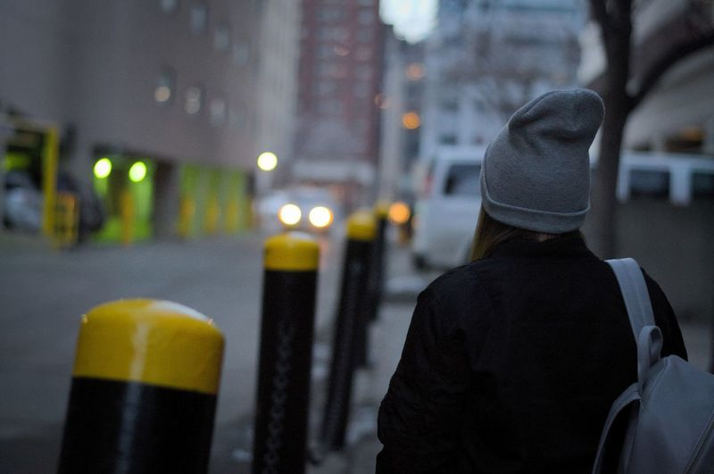 Backpack Beanie Beauty In Nature Building Exterior Built Structure City City Life Exploring Exploring New Ground Focus On Foreground Illuminated Men Night One Person Outdoors People Perspective Real People Rear View Street Street Life Street Photography