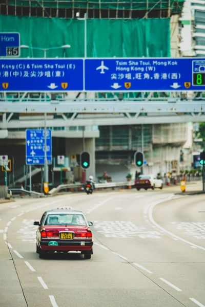 Streetphotography Discoverhongkong Artisanandartist Reframinghk Transportation Mode Of Transportation Car Road Sign Motor Vehicle City Symbol Built Structure Marking Road Marking Arrow Symbol Travel Communication Incidental People Land Vehicle Architecture Street Road Sign Text