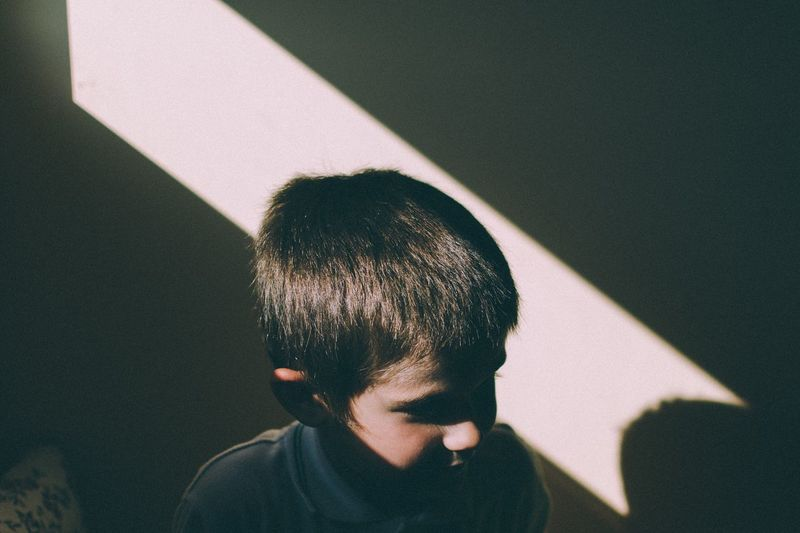 Close-Up Of Child In Sunlight