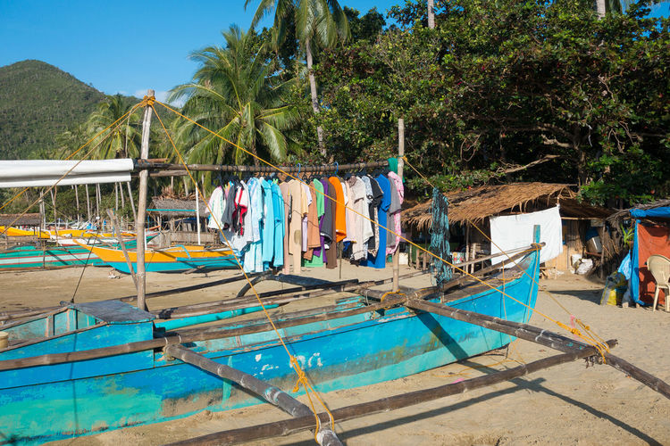 Laundry hanging on a rustic old fishing boat on a Palawan beach Bangka Clothes Drying Creative Solution Filipino Filipino Culture Fishing Boat Fishing Village Ingenious Ingenuity Island Living It's More Fun In The Philippines Laundry Drying Philippines Philippines Photos Pinoy Problem Solving Provinces Rustic Charm Rustic Village Simple Life Simple Living Village Life Village Lifestyle Village Scene Village View