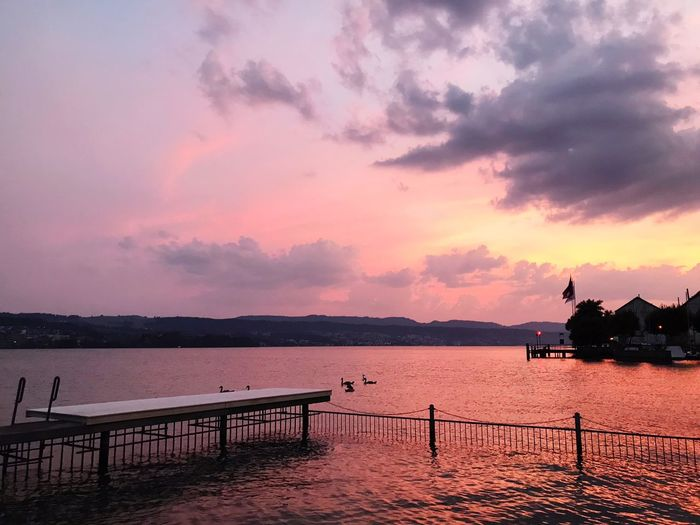 Badi Uetikon, Lake Zurich, at Sunset with a red sky. Sky Sunset Cloud - Sky Water Beauty In Nature Scenics - Nature Silhouette Nature Tranquil Scene Sea Architecture Built Structure Tranquility No People Pier Idyllic Outdoors Dusk Orange Color