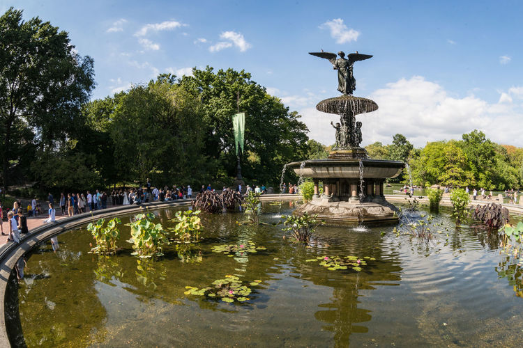 People By Bethesda Terrace And Fountain At Central Park Against Sky