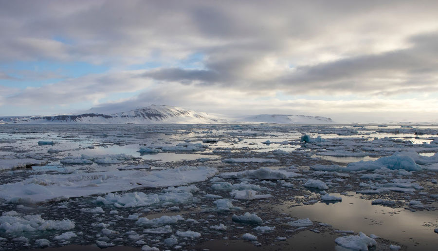 The beauty of the seas and mountain of Svalbard in the Arctic Arctic Svalbard  Spitsbergen Water Reflections Cold Temperature Snow Ice Mountains Arctic Circle