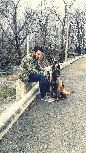Man with dog sitting on floor