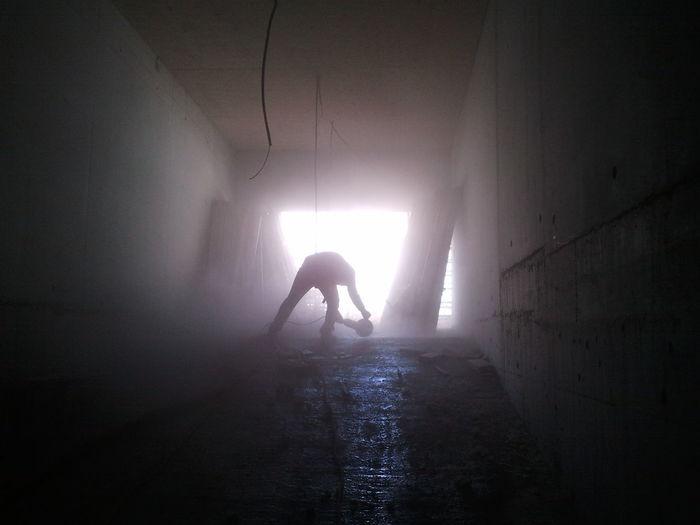 Silhouette of man in fog
