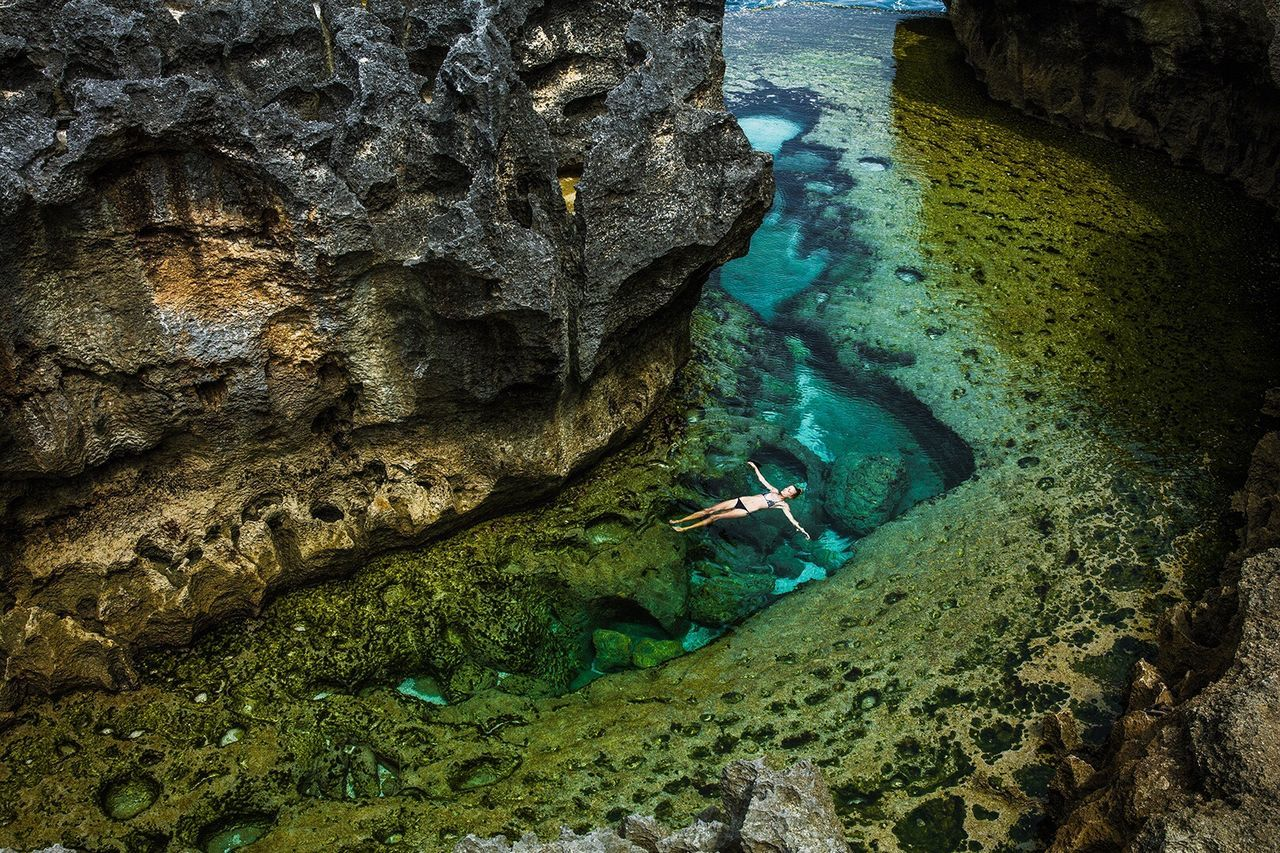 rock formation, rock - object, water, high angle view, nature, sea, beauty in nature, cave, day, beach, nautical vessel, vacations, outdoors, full length, no people