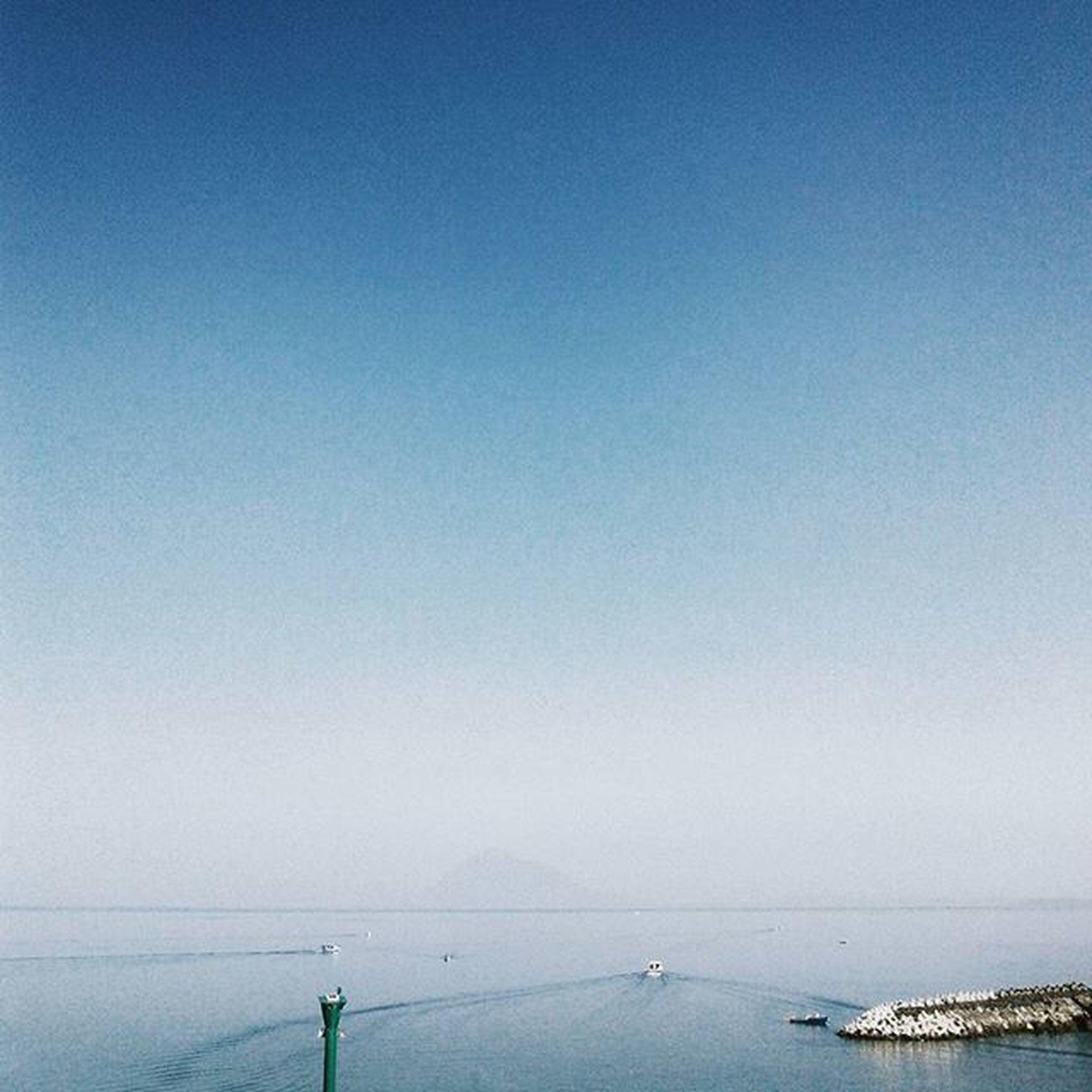 sea, water, horizon over water, copy space, clear sky, tranquility, tranquil scene, scenics, blue, beauty in nature, beach, nature, transportation, nautical vessel, idyllic, shore, outdoors, coastline, calm, day