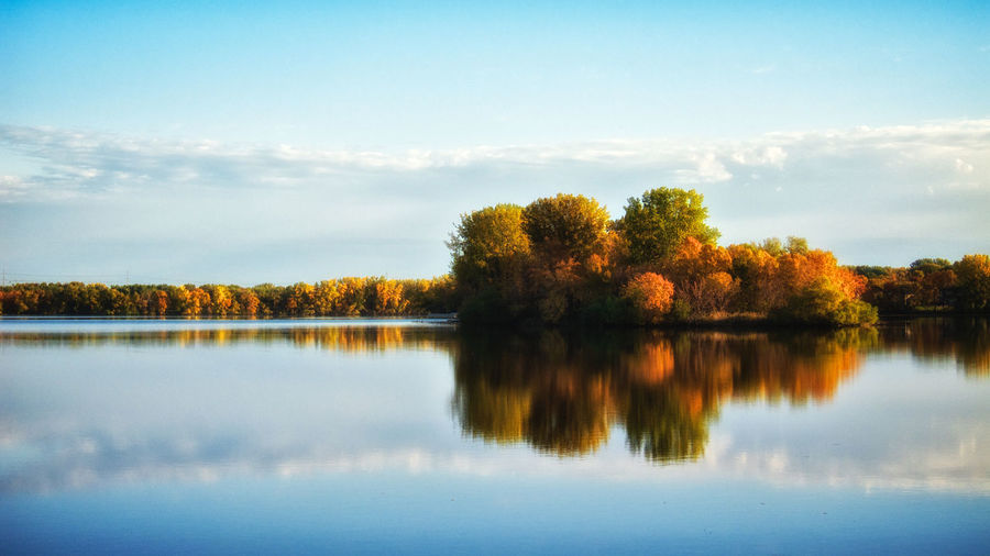 Island of Reflection. A calm autumn morning provides pristine water for a beautiful reflection. Autumn Autumn Colors Calm Clouds Lake Reflection Tranquil Scene Water Showcase: January