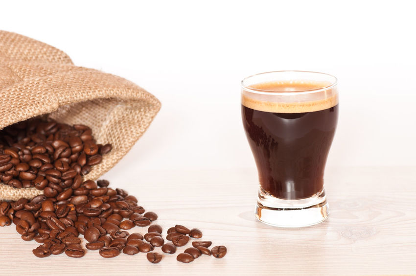 Brown Close-up Coffee - Drink Coffee Bean Coffee Cup Day Drink Food Food And Drink Freshness Frothy Drink Indoors  No People Raw Coffee Bean Refreshment Roasted Coffee Bean Still Life Studio Shot Table White Background