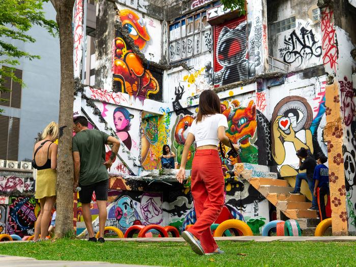 Streetphotography Colorful Multi Colored Tree City Building Exterior Architecture Grass Street Art Graffiti Art Modern Art ArtWork Friend