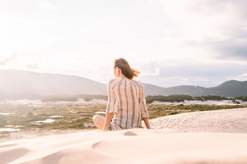Brasil Casual Clothing Day Dunes Florianópolis Full Length Leisure Activity Mountain Nature One Person Outdoors Real People Rear View Relaxation Sand Sand Dune Scenics Sun Sunlight Sunset Tranquility Vacations Women Young Adult Young Women