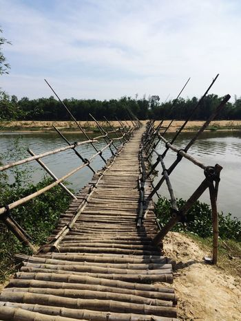 Bamboo bridge Bridging Cycling Trip  Journey Travel ASIA Vietnam Water Bamboo Bridge Bridge Bamboo Sky Nature Plant Cloud - Sky Day Water Tranquility Direction No People The Way Forward Tranquil Scene Land Scenics - Nature Beauty In Nature Outdoors Wood - Material River Footpath Diminishing Perspective