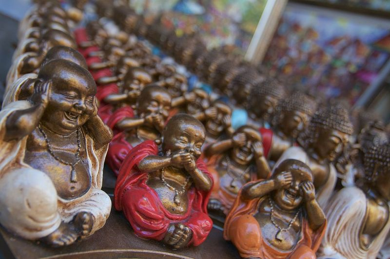 Dozen of small colored buddhas statues displayed on a stall at the Ubud Market, Indonesia Balinese Culture Bali Ubud Market Ubud Art And Craft Representation Statue Belief Religion Spirituality No People Close-up In A Row Ornate Market Balinese Asian  ASIA Happiness Buddhism Coulored Colorful Handicraft Smiling Souvenir Sky