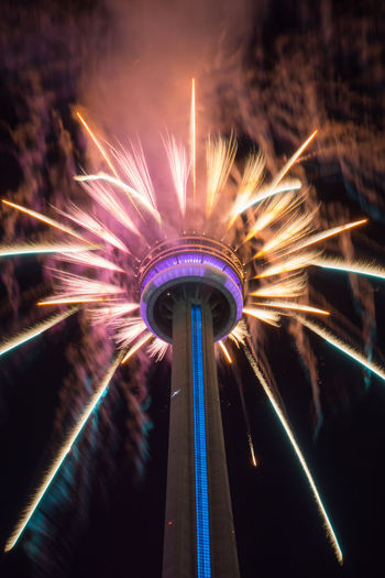CN Tower Canada Day 2017 Fireworks Toronto Arts Culture And Entertainment Built Structure Celebration Explosion Of Color Firework Firework Display Illuminated Long Exposure Low Angle View Night Sky
