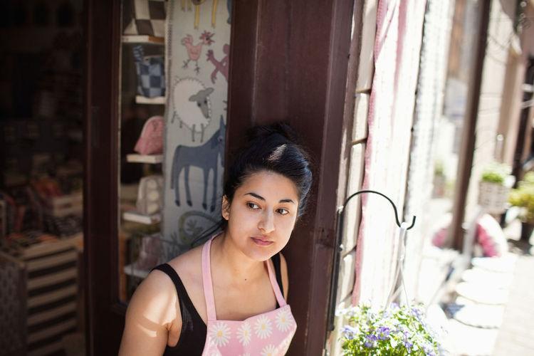 Portrait of beautiful woman at window