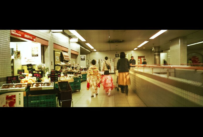 Real People City Life Lifestyles Architecture Indoors  Transportation Filmisalive Illuminated Filmcamera Emilrauschenberg Filmisnotdead Streetphotography EyeEmNewHere Filmphotography Filmcommunity Magnumphotos Film Photography Arts Culture And Entertainment Xpan 70mm